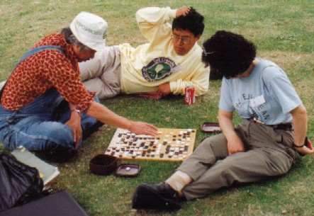 Oriental friends playing Go